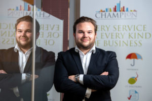 Champion promotes former trainee to Group Partner as it celebrates its 50th birthday
